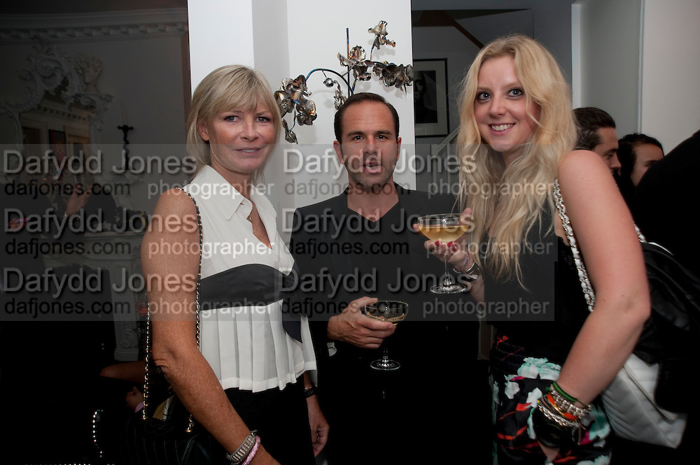 PANDORA DELEVIGNE; JAMES SERVINI; KITTY COOPER, Party at the home of Amanda Eliasch in Chelsea after the opening of As I Like it. A memory by Amanda Eliasch and Lyall Watson. Chelsea Theatre. Worl's End. London. 4 July 2010<br /> <br />  , -DO NOT ARCHIVE-© Copyright Photograph by Dafydd Jones. 248 Clapham Rd. London SW9 0PZ. Tel 0207 820 0771. www.dafjones.com.