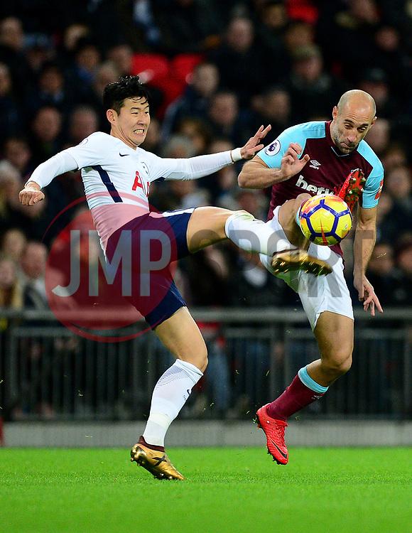 Son Heung-Min of Tottenham Hotspur fouls Pablo Zabaleta of West Ham United - Mandatory by-line: Alex James/JMP - 04/01/2018 - FOOTBALL - Wembley Stadium - London, England - Tottenham Hotspur v West Ham United - Premier League