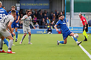 AFC Wimbledon midfielder Anthony Wordsworth (40) stretching to keep the ball in play during the EFL Sky Bet League 1 match between AFC Wimbledon and Portsmouth at the Cherry Red Records Stadium, Kingston, England on 19 October 2019.