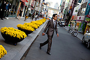 Daegu/South Korea, Republic Korea, KOR, 16.10.2009: Man with a suit passing a street in the center of the South Korean city of Daegu.