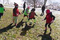 """The AYSO youth soccer league practiced Sunday afternoon in Jackson Park.<br /> <br /> 7599 – Kids participate in a scrimmage. <br /> <br /> Please 'Like' """"Spencer Bibbs Photography"""" on Facebook.<br /> <br /> All rights to this photo are owned by Spencer Bibbs of Spencer Bibbs Photography and may only be used in any way shape or form, whole or in part with written permission by the owner of the photo, Spencer Bibbs.<br /> <br /> For all of your photography needs, please contact Spencer Bibbs at 773-895-4744. I can also be reached in the following ways:<br /> <br /> Website – www.spbdigitalconcepts.photoshelter.com<br /> <br /> Text - Text """"Spencer Bibbs"""" to 72727<br /> <br /> Email – spencerbibbsphotography@yahoo.com"""