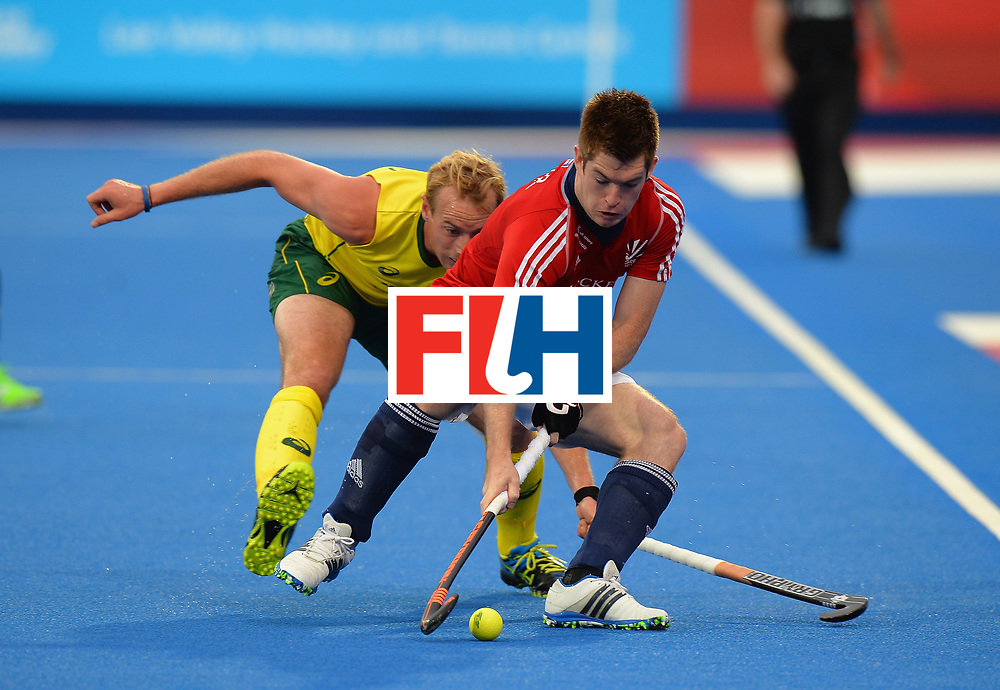 LONDON, ENGLAND - JUNE 10:  Henry Weir of Great Britain is tackled by Aran Zalewski of Australia during the FIH Men's Hero Hockey Champions Trophy 2016 - Day One match between Great Britain and Australia at Queen Elizabeth Olympic Park on June 10, 2016 in London, England.  (Photo by Tony Marshall/Getty Images)