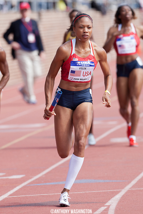Allyson Felix with the USA red team, runs the second leg of the USA vs. the World Women 4x400 at the Penn Relays athletics meet Saturday, April 28, 2012 in Philadelphia, PA.