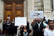 Roma, 19 Maggio  2014<br /> Manifestazione di Action diritti in movimento  davanti la sede di Banca Intesa San Paolo, in piazza del Parlamento, proprietaria di un stabile in via Tuscolana, occupato da due anni da più di 100 famiglie  di senza casa, che chiede il sequestro dell'immobile  per metterlo all'asta.<br /> Rome, May 19, 2014 <br /> Demostration  Action  Rights in motion in front of the headquarters of Banca Intesa San Paolo, in Parliament Square, which owns a building in Via Tuscolana occupied for two years by more than 100 families homeless, seeking the seizure of the property for  to put it auction.