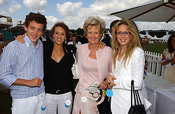 LADY CHADLINGTON and her children, left to right, the HON. JAMES GUMMER, the HON.CHLOE GUMMER and the HON.NAOMI GUMMER at the Cartier International polo at Guards Polo Club, Windsor Great Park, on 30th July 2006.<br />