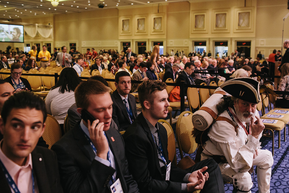 William Temple, right, dressed as a minuteman, waits for the start of day two of the Conservative Political Action Conference (CPAC) at the Gaylord National Resort & Convention Center in National Harbor, Md.
