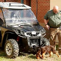 Jimmy Wiygul, K-9 handler for at the Calhoun County Sheriff's department walks Duke around the outside of the department. Duke is the Calhoun County Sheriff's department new Bloodhound puppy.