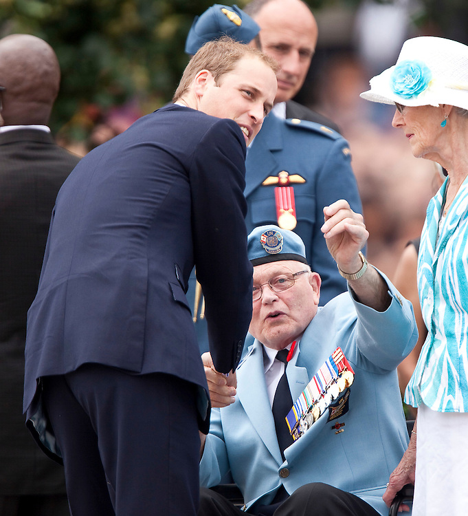 Britain's Prince William speaks to veterans during a ceremony at the National War Memorial in Ottawa, Canada, June 30, 2011, the first stop on a nine-day tour of Canada and the first official foreign trip with Catherine the Duchess of Cambridge as husband and wife.<br /> AFP PHOTO/GEOFF ROBINS