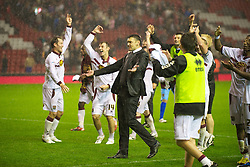 LIVERPOOL, ENGLAND - Wednesday, September 22, 2010: Northampton Town's manager Ian Sampson celebrates a famous victory over Liverpool after a penalty shoot-out during the Football League Cup 3rd Round match at Anfield. (Photo by David Rawcliffe/Propaganda)
