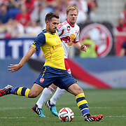 Aaron Ramsey, (left), Arsenal, in action during the New York Red Bulls Vs Arsenal FC,  friendly football match for the New York Cup at Red Bull Arena, Harrison, New Jersey. USA. 26h July 2014. Photo Tim Clayton