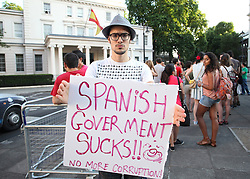 © Licensed to London News Pictures . 18/07/2013 . London, UK. Spanish citizens living in London protest against Federico Trillo-Figueroa, the Spanish ambassador to Britain, outside the Spanish Embassy in Belgrave Square, London. Mr Trillo-Figueroa has been recently accused of receiving €128,000 from a secret slush fund while serving as Defence Minister for the centre-right Popular Party (PP) Government of José Maria Aznar, former Prime Minister. The accusations were made by former treasurer of the Popular Party Luis Bárcenas, who is currently awaiting a trial on fraud charges.Photo credit : /LNP