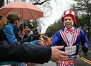 Randy Giveans, of Texas, gives a chain of high fives during the 119th running of the Boston Marathon along Central Street in Wellesley, April 20, 2015.   (Wicked Local Photo/James Jesson).