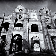 Church of San Juan Del Monte, first built in 1602-1604 by Dominican Province of the most holy rosary. It was burned during the Chinese uprising of 1639; rebuilt in 1641 and was again set afire during British occupation in 1763. Finally constructed in its present state in 1774, it was used by the insurgent forces of the 1898 revolution. The sanctuary is the seat of the co-fraternity of Santisimo Cristo De San Juan Del Monte approved by Pope Innocent X on 3/4/1648.
