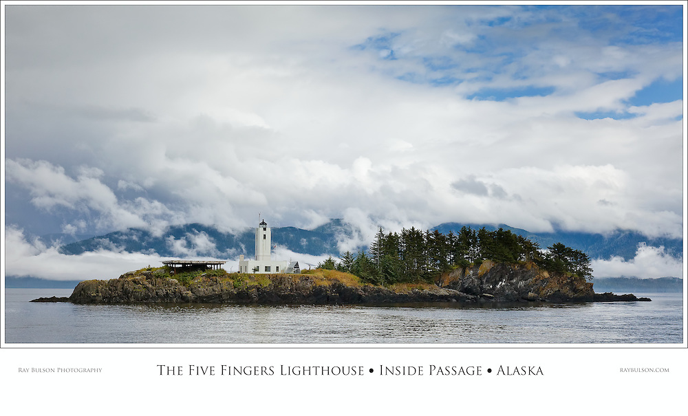 Fog and clouds highlight the need for The Five Fingers Lighthouse in Stephens Passage in the Inside Passage of Southeast Alaska. Summer. Afternoon.