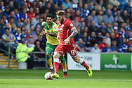 Aron Gunnarsson of Cardiff city &copy; makes a break. Skybet football league championship match, Cardiff city v Norwich city at the Cardiff city Stadium in Cardiff, South Wales on Saturday 13th Sept 2014<br /> pic by Andrew Orchard, Andrew Orchard sports photography.