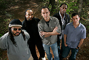 5/4/2005 -- Charlottesville, VA, U.S.A -- The Dave Matthews Band is about to release a new studio album entitled Stand Up.   Posing in the woods near their studio are, from left, LeRoi Moore, Carter Beauford, Matthews, Boyd Tinsley and Stefan Lessard.   Photo by H. Darr Beiser, USA TODAY staff  (Via MerlinFTP Drop)