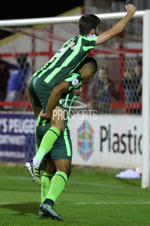 George Francomb of AFC Wimbledon jumps on the back of Lyle Taylor of AFC Wimbledon  after he puts the Dons ahead for the first time in the game during the Sky Bet League 2 match between Accrington Stanley and AFC Wimbledon at the Fraser Eagle Stadium, Accrington, England on 20 October 2015. Photo by Stuart Butcher.