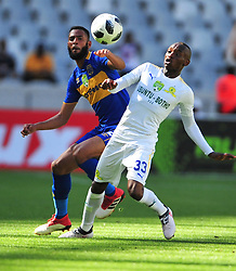 Cape Town--180401  Mamelodi Sundowns striker Khama Billiat challenged by Taariq Fielies of Cape Town City during the Nedbank Cup quarter final game at the Cape Town Stadium.Sundowns won the game 2-1 and will play maritzburg in the Semi-final  .Photographer;Phando Jikelo/African News Agency/ANA