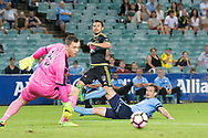 February 8, 2017: Wellington Phoenix Vince LIA (17) gets it past Sydney FC goalkeeper Danny VUKOVIC (20) and Sydney FC defender Alex WILKINSON (4), but just misses the goal at Round 19 of the 2017 Hyundai A-League match, between Sydney FC and Wellington Phoenix played at Allianz Stadium in Sydney. Sydney FC won the game 3-1.