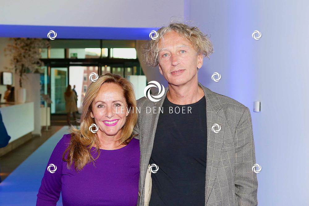 AMSTERDAM - In het EYE is de filmpremière van Borgman. Met hier op de foto  Angela Groothuizen met partner Rob Mooij. FOTO LEVIN DEN BOER - PERSFOTO.NU