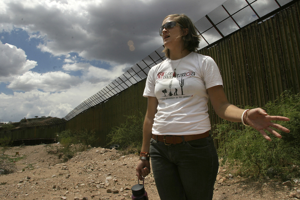 Maryada Vallet, a volunteer with the No More Deaths humanitarian organization, stands next to the Mexican-US border wall on the Mexican side of the border town of Nogales on 13 July 2006.....