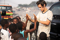 Harry Style from One Direction with Fridous, 7 (in blue). The 5 Band members of One Direction visited a rubbish tip in Agbogbloshie slum, Accra, Ghana, late Jan 2013