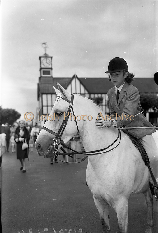 """08/08/1962<br /> 08/08/1962<br /> 08 August 1962 <br /> Dublin Horse show at the RDS, Ballsbridge, Dublin, Wednesday. Image shows Miss Juliana (Juliama?) Brooke, eldest daughter of the Hon. Capt. and Mrs John Brooke, patting her pony """"Andy Pandy"""" a prize winner in Class 54 Children's Pony (4 years and over- over 12.2 hands) at the show."""
