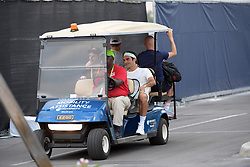 March 26, 2019 - Miami Gardens, Florida, United States Of America - MIAMI GARDENS, FLORIDA - MARCH 26: (EXCLUSIVE COVERAGE) Roger Federer arrives on a golf cart for practice court day 9 of the Miami Open presented by Itau at Hard Rock Stadium on March 26, 2019 in Miami Gardens, Florida...People: Roger Federer. (Credit Image: © SMG via ZUMA Wire)