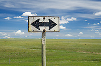 Weathered road sign near Choteau Montana