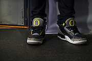 A fan wearing Oregon Ducks shoes at the College Football Playoff National Championship Game between the Oregon Ducks and the Ohio State Buckeyes at AT&T Stadium on January 12, 2015 in Arlington, Texas.  (Cooper Neill for The New York Times)