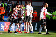 Sheffield Utd forward Scott Hogan (11) celebrates with team mates after putting United 2-1 up during the EFL Sky Bet Championship match between Sheffield United and Bristol City at Bramall Lane, Sheffield, England on 30 March 2019.