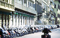 Long line of scooters / mopeds in Florence, Italy.