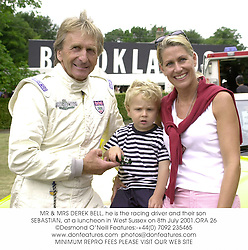 MR & MRS DEREK BELL, he is the racing driver and their son SEBASTIAN, at a luncheon in West Sussex on 8th July 2001.	ORA 26