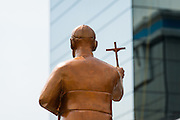 A golden statue of martyred Archbishop Oscar Romero stands against a high rise office building across from the Plaza El Salvador Del Mundo (Savior of the World) where preparations are being made for Saturday's ceremony and mass announcing the beatification of Archbishop Oscar Romero. The Archbishop was slain at the alter of his Church of the Divine Providence by a right wing gunman in 1980. Oscar Arnulfo Romero y Galdamez became the fourth Archbishop of San Salvador, succeeding Luis Chavez, and spoke out against poverty, social injustice, assassinations and torture. Romero was assassinated while offering Mass on March 24, 1980.