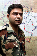 "Rahul Sharma head of the police in Dantewada district is seen standing in his command centre with a map showing inaccessible roads and areas in the district.  His assessment was that 40 per cent of the state was in naxal hands, 40 per cent was held by the government and they were fighting over the remaining 20.  ""It is the biggest casualty theatre for the Indian government in the country.  It is a full blown war and the naxals are migrating from guerillas to a full blown conventional army."""