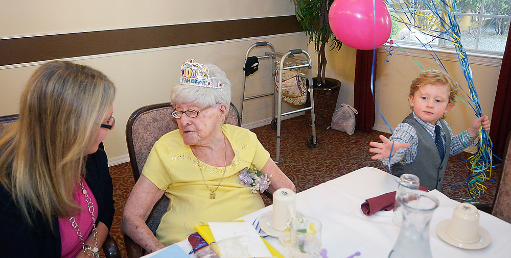 gbs072717h/LIFE  -- Rosalyn Zimmerman of Albuquerque  talks with her granddaughter Sara Penn of Albuquerque as her great grandson Raviv Zimmerman, 4, gathers ballons during her 100th birthday party at Atria Vista del Rio assisted living facility on Thursday, July 27, 2017. (Greg Sorber/Albuquerque Journal)