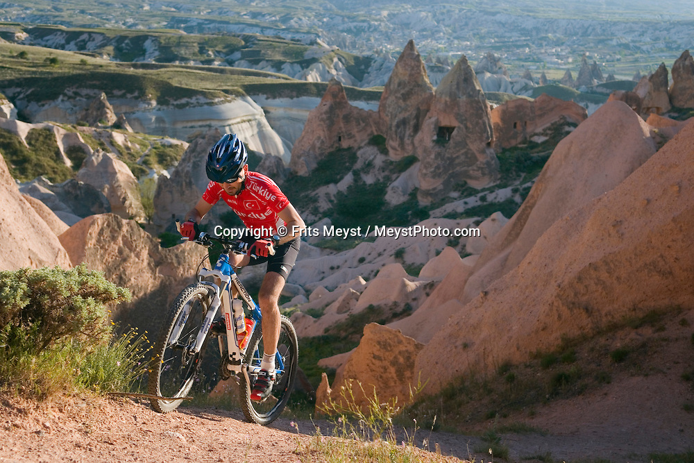 Cappadocia, Nevsehir, Turkey, May 2010. Mountainbikers ride the trails through Rose Valley and Red Valley between Goreme and Cavusin. The fairy landscape of Goreme National Park is unique in its kind. Millions of years long, wind and water sculpted the tuffstone into spectacular rock formations.  Photo by Frits Meyst/Adventure4ever.com