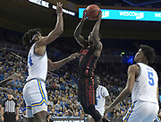 Nov 15, 2019; Los Angeles, CA, USA; UNLV Rebels guard Amauri Hardy (3) is defended by UCLA Bruins forward Jalen Hill (24) and guard Chris Smith (5) in the first half at Pauley Pavilion. UCLA defeated UNLV 71-54.