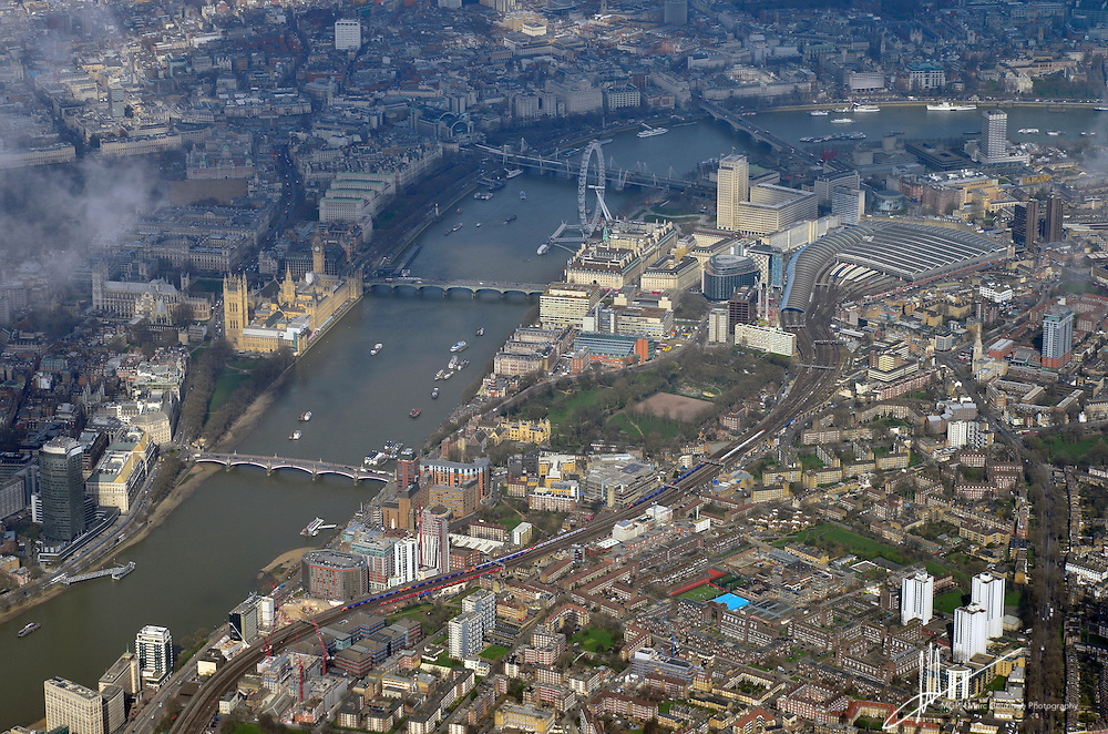 Aerial view of The Thames Embankment and Westminster; showing The houses of Parliament, Big Ben, Westminster Abbey, Whitehall, Charing cross station, the London Eye, Waterloo Station, King's college, Lambeth Palace Gardens. March 2014