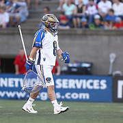 Adam Ghitelman #8 of the Charlotte Hounds walks on the field during the game at Harvard Stadium on May 17, 2014 in Boston, Massachuttes. (Photo by Elan Kawesch)