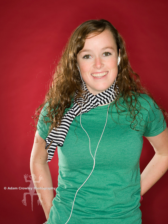 female teen w/ear bud headphones, smiling