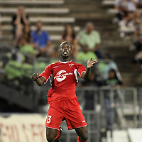 Orlando City Lions Midfielder Lawrence Olum (13) heads the ball during a United Soccer League Pro soccer match between the Wilmington Hammerheads and the Orlando City Lions at the Florida Citrus Bowl on June 18, 2011 in Orlando, Florida.  (AP Photo/Alex Menendez)