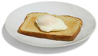 Poached egg on toast on white background