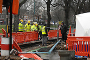 © Licensed to London News Pictures. 23/02/2010. London, UK. The Inquest opens today, 14th May 2012, into the death of a baby fatally injured by a falling lamp post. Tommy Hollis died on February 25 2010, a day short of his first birthday and two days after the incident in Chiswick, west London. FILE PICTURE: Workmen inspect the lamppost on the day it fell (blue on ground). Photo credit : Stephen Simpson/LNP