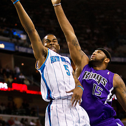 December 15, 2010; New Orleans Hornets guard Marcus Thornton (5) shoots over Sacramento Kings power forward DeMarcus Cousins (15) during the first half at the New Orleans Arena.  Mandatory Credit: Derick E. Hingle