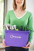 Woman Carrying Box with Recycleables