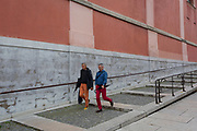 Two men walk down the steps on Miklosiceva Cesta (street) in the Slovenian capital, Ljubljana, on 28th June 2018, in Ljubljana, Slovenia.