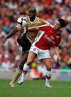 Photo: Richard Lane/Richard Lane Photography. Arsenal v Juventus. Emirates Cup. 02/08/2008. Arsenal's Samir Nasri  is tackled by Juventus' Mohamed Sissoko.