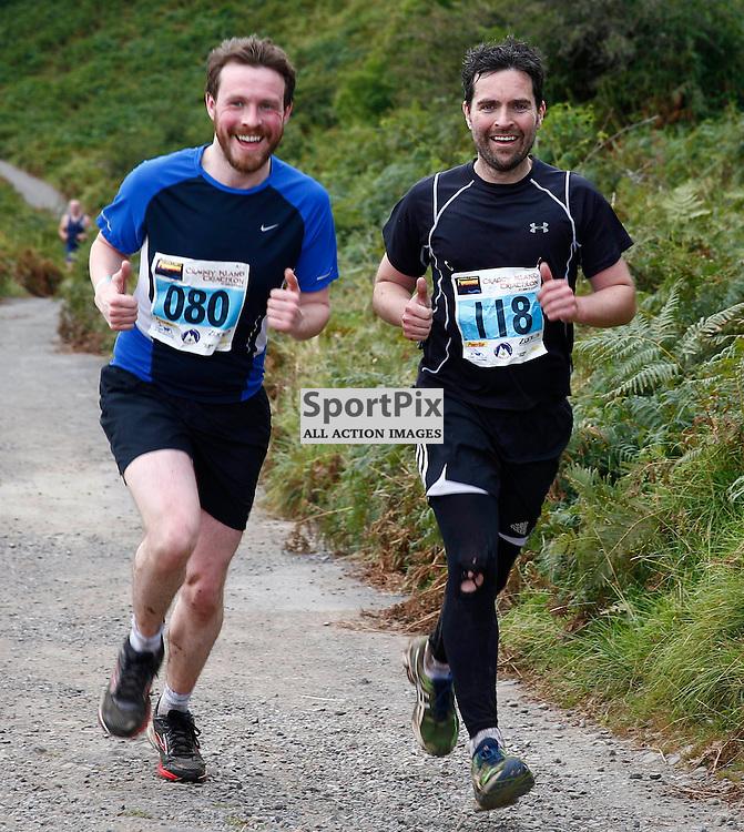CRAGGY ISLAND TRIATHLON..... Iain Harper (L) and Bradley MacDonald (R) competing in Craggy Island Triathlon..(c) STEPHEN LAWSON   SportPix.org.uk
