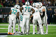 The Miami Dolphins offense huddles and calls a play during the NFL week 8 regular season football game against the Houston Texans on Thursday, Oct. 25, 2018 in Houston. The Texans won the game 42-23. (©Paul Anthony Spinelli)